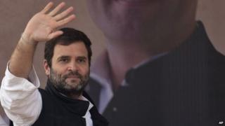 India's opposition Congress party Vice President Rahul Gandhi waves to the crowd during an election campaign rally ahead of Delhi state election in New Delhi, India, Wednesday, Feb. 4, 2015