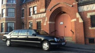 Funeral car outside church