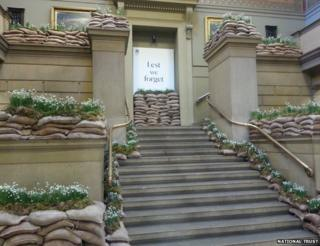 snowdrops on sandbags line staircase of art gallery