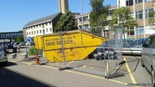Skip using two disability parking spaces, Addenbrooke's Hospital, Cambridge