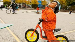 A child at a cycling playground in Denmark