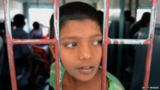 A rescued Indian child labourer looks out the window of a Patna-bound express train at a railway station in Secunderabad on 5 February
