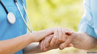 Nurse caring for elderly man