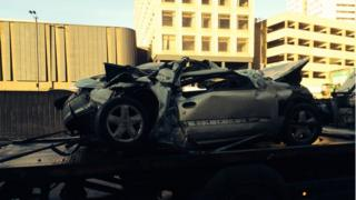 One of the cars in the crash