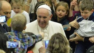 Pope Francis (C) greets the crowd during his weekly general audience at Paul VI audience hall on February 4, 2015 at the Vatican