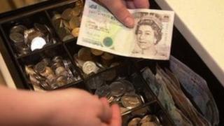 Cashier handling money