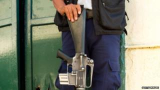 Mexican Policeman leaning on his gun