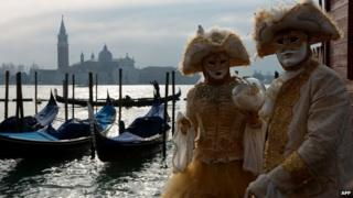"Costumed revellers pose at St Mark""s square during the Venice Carnival on February 8, 2015 in Venice."