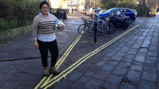 Kika Hedgecock standing next to the bicycle parking bay with double yellow lines around it