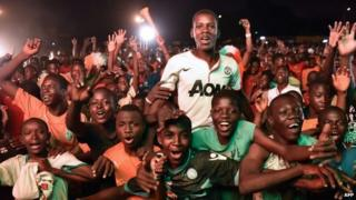 Ivory Coast fans celebrate winning the Africa Cup of Nations in the capital of Abidjan