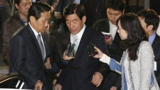 File photo: former National Intelligence Service director Won Sei-hoon, centre, leaves the Supreme Prosecutors' Office in Seoul, South Korea, 30 April 2013
