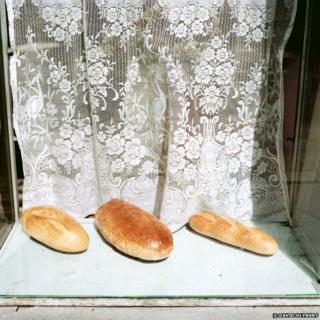 Krakow, Poland, 1988, Three loaves of bread. Photograph by © David Hlynsky