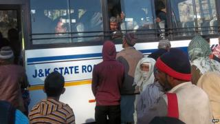 Passengers board an Indian Jammu and Kashmir state government bus departing to Pakistan-controlled Kashmir, at the Chakan-da-Bagh outpost near Poonch, some 250 kilometres from Jammu, the winter capital of Kashmir, on 28 January 2013