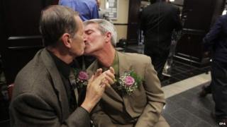 Robert Povilat (L) and Milton Persinger kiss to celebrate the US Supreme Court's decision to not stop same-sex marriages in Alabama, in Mobile, Alabama, USA, 09 February 2015