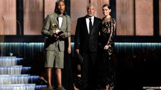 Pharell Williams accepts a Grammy wearing a shorts-suit.