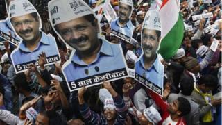 Supporters of Aam Aadmi (Common Man) Party (AAP) hold portraits of Arvind Kejriwal, during celebrations outside their party office in Delhi February 10, 2015