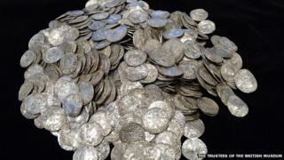 A pile of 697 coins