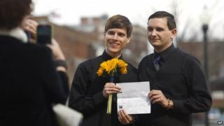 Justin Lewis and Shawn Williams show off their marriage licence after having to drive to Montgomery, Ala., to get it after being refused in Lee County on 9 February 2015