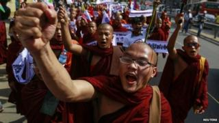 Buddhist monks and other people take part in a protest to demand the revocation of the right of holders of temporary identification cards, known as white cards, to vote, in Yangon February 11, 2015