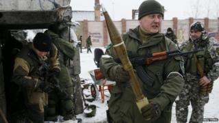 A pro-Russian separatist shows an anti-tank missile in the town of Vuhlehirsk, eastern Ukraine