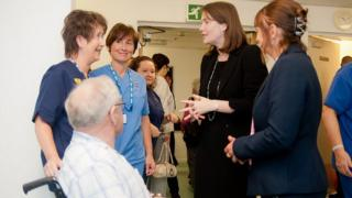 Kirsty Williams with hospital staff and patients