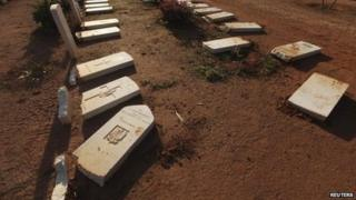 Headstones broken at the Benghazi War Cemetery and the Benghazi British Military Cemetery