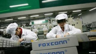 Employees into a Foxconn factory