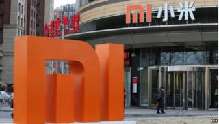 """A large logo of Chinese mobile phone product manufacturer Xiaomi at Xiaomi""""s headquarters in Beijing, China,"""