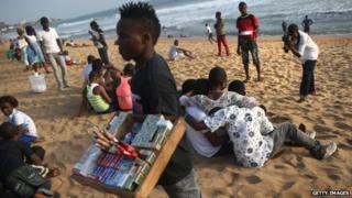 People on the beach in Monrovia, Liberia