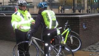 Met officer talks to cyclist at spot checks in Vauxhall last Monday