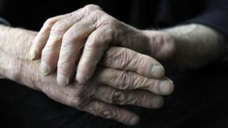 An elderly man's hands