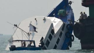 This file picture taken on 2 October 2012 shows the bow of the Lamma IV boat partially submerged during rescue operations after it collided with a Hong Kong ferry