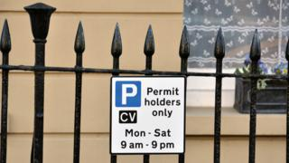 Signs on railings in Clifton Village