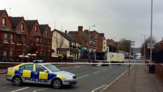 Bomb disposal officers are examining a suspicious object at Clifton Crescent