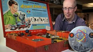Dr Mike Simms with the Gilbert Atomic Energy Lab, which is on display in the Elements exhibition at the Ulster Museum