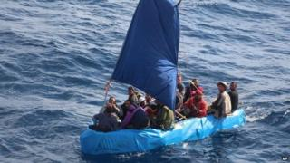 A US Coast Guard photo shows Cuban migrants in the waters south of Key West on 1 January 2015