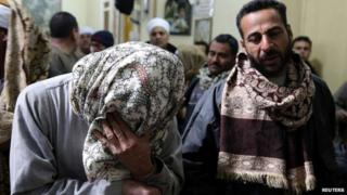 A relative of one of the Egyptian men killed Libya mourns in a village south of Cairo