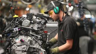 man in car factory