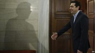 Greek Prime Minister Alexis Tsipras welcomes Eurogroup President Jeroen Dijsselbloem (not pictured) during their meeting in Athens on 30 January 2015