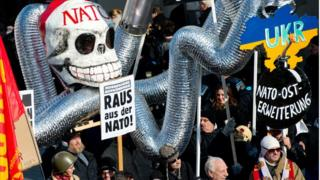 "Demonstrators take part in a protest titled ""There is no Peace with NATO"" in front of the venue of the 51st Munich Security Conference in Germany on February 7, 2015."