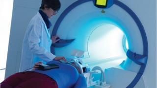Researcher and volunteer at MRI scanner