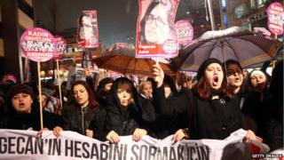 Women shout slogans and hold a portrait of 20-year-old Ozgecan Aslan, during a demonstration against Aslan's murder in Ankara