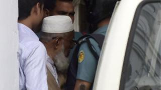 Abdus Subhan is taken into a van following his verdict at a special court in Dhaka on February 18
