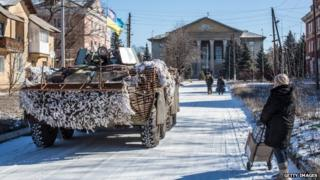 Ukrainian forces pass through the centre of town on February 17, 2015 in Myronivskyi, Ukraine