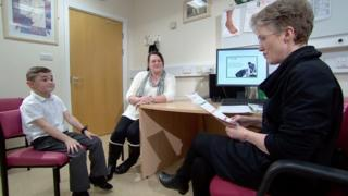 Dr Karen Horridge with a patient, Matthew and his mum