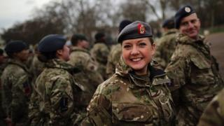 Military personnel prepare to march into the Houses of Parliament on January 26, 2015