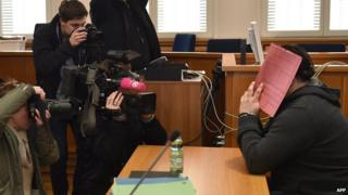 German former male nurse Niels H (R) is in the focus of photographers and cameramen as he waits for his trial on February 2015 at court in Oldenburg