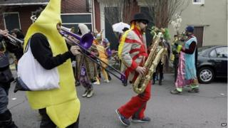 Man dressed as banana with a trombone
