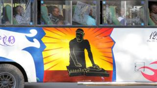 art work of a Dj on the decks decorates a bus