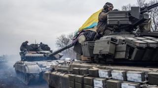 Ukrainian troops drive tanks out of Debaltseve. 19 Feb 2015